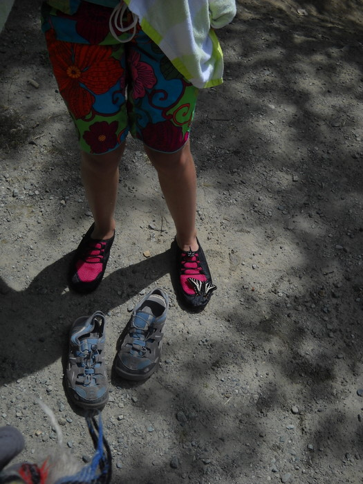 a butterfly landed on her water shoe